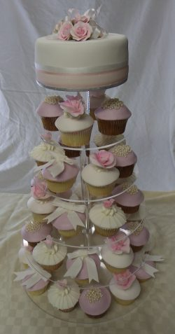 Pink rose, bows & pearls wedding cake