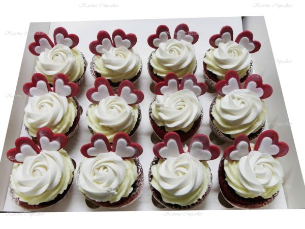 Red velvet cupcakes with a Classic Rose Swirl Cupcakes with Red and White Hearts