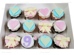Number Birthday Cupcakes with Pastel Bows and Hearts