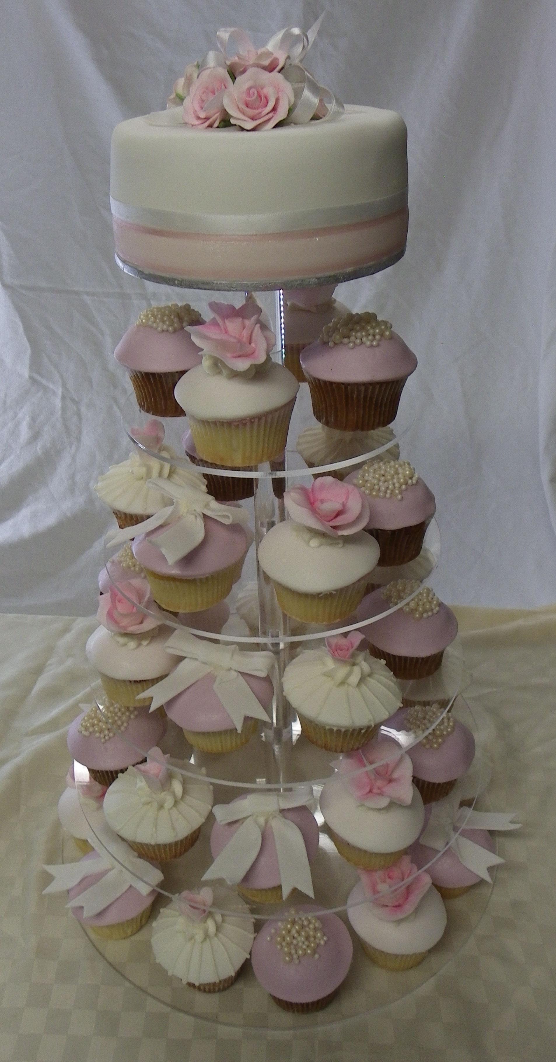 Pink rose, bows & pearls wedding cake