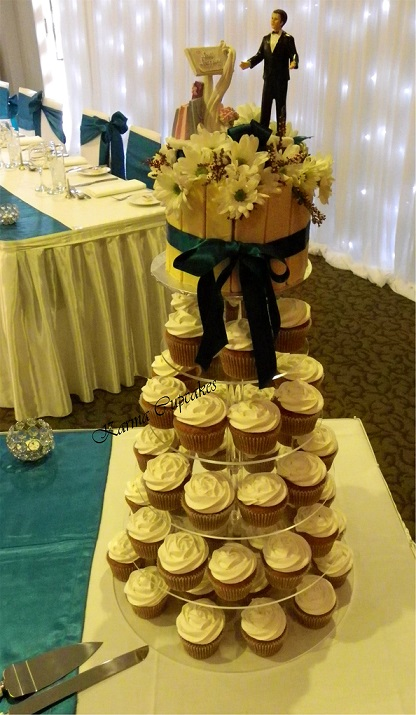 Classic White Chocolate Wedding Cupcake tower topped with fresh flowers