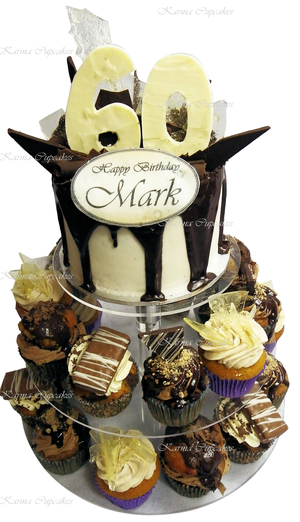 Male 60th chocolate birthday cake with cupcakes. copy