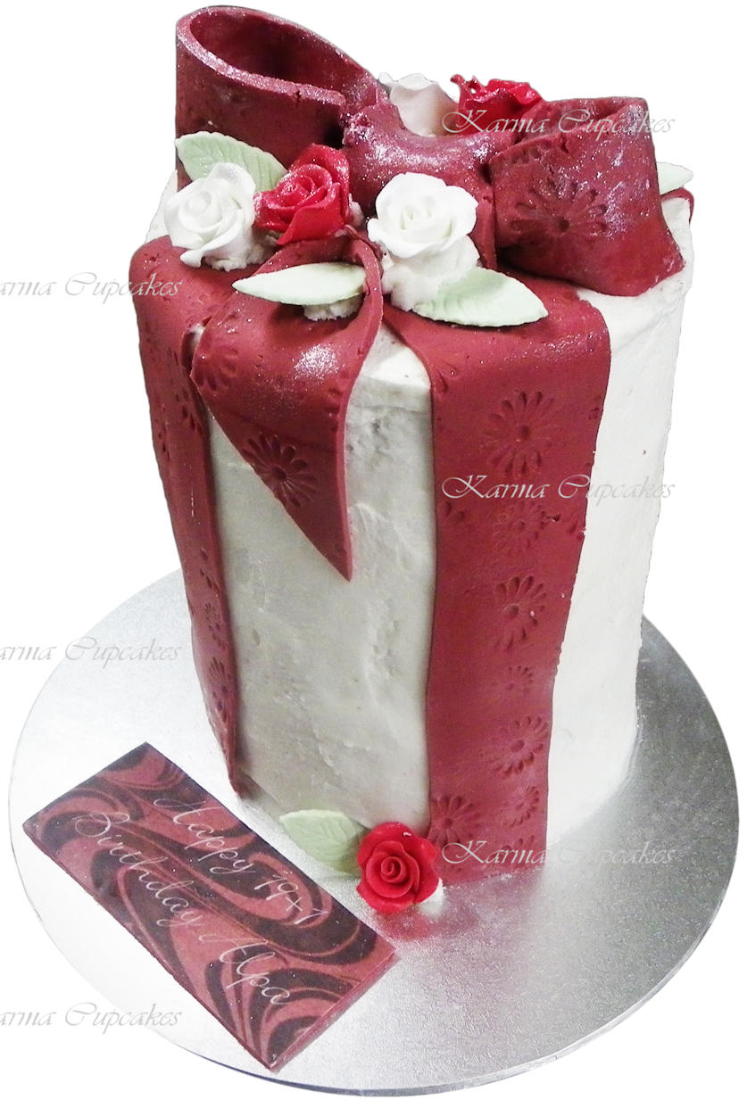 Red velvet buttercream cake with bow and sugar flowers copy