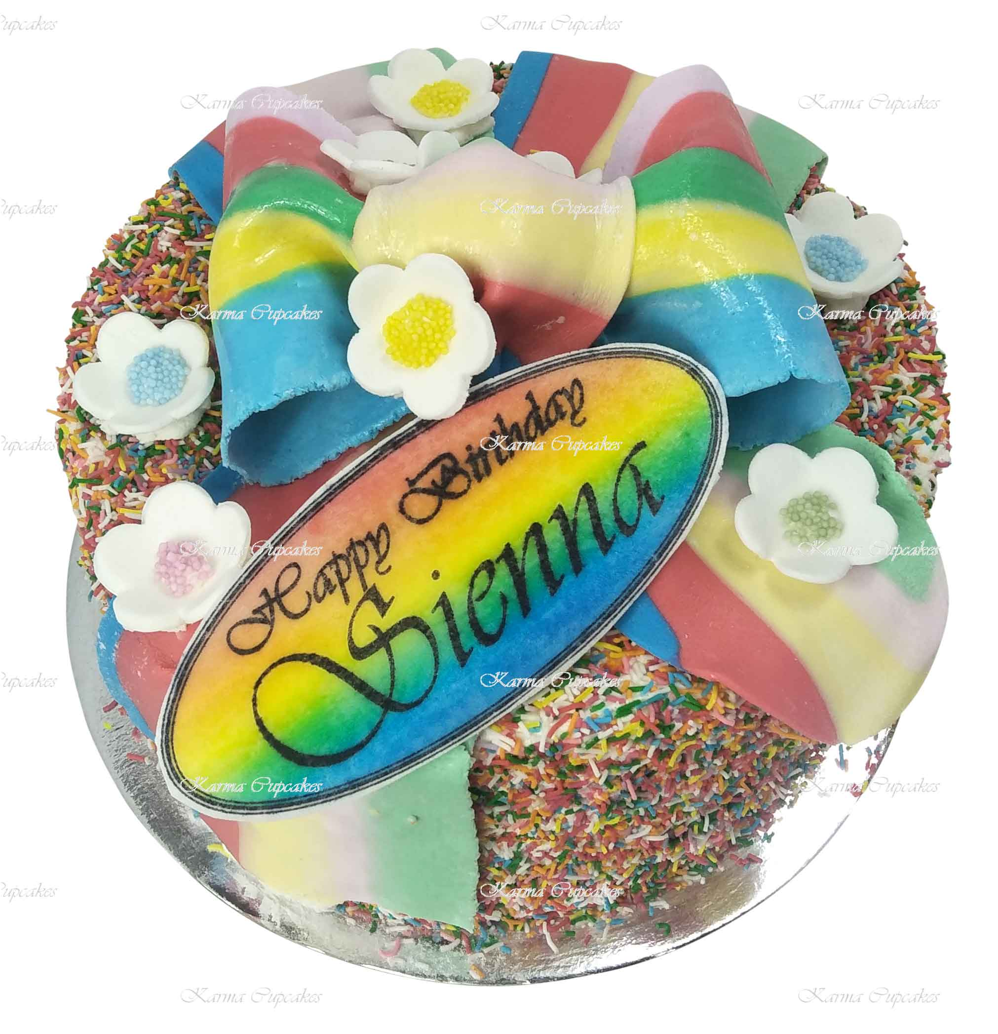 Rainbow-edible-ribbon-and-flowers-hundreds-and-thousands