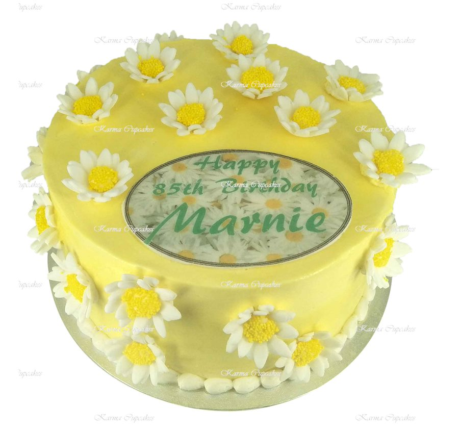 Yellow-iced-cake-with-yellow-daisies